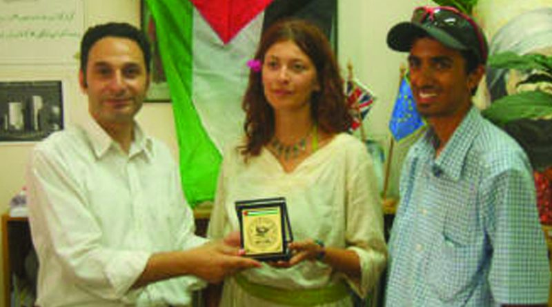 The Peace Cycle Concludes its Ride and Presents its Guestbook to An-Najah National University